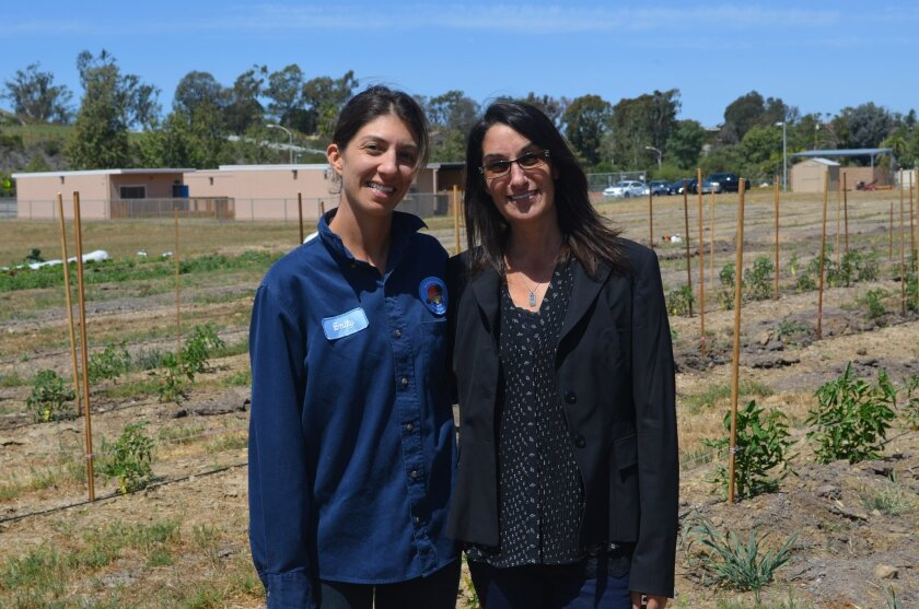 District farmer Emily Staalberg (left) and Mim Michelove, co-founder of Healthy Day Partners, at the 10-acre Encinitas Union School District farm, which will soon host students.