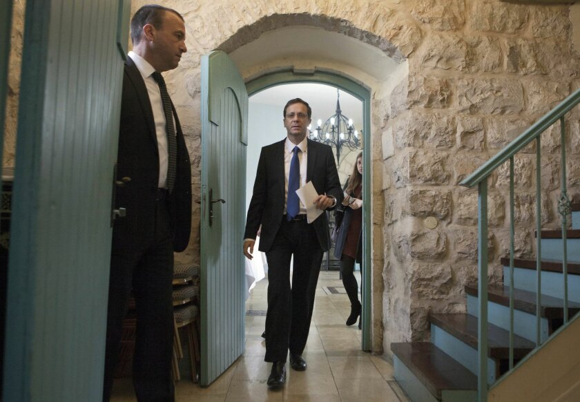 "Israel's Labor Party leader Isaac Herzog arrives to a press conference in Jerusalem, Tuesday, Feb. 24, 2015. Herzog said the upcoming speech by Prime Minister Benjamin Netanyahu at the U.S. Congress on Iran is ""spin"" ahead of March elections. Herzog is competing against Netanyahu in the March 17 election. (AP Photo/Dan Balilty)"