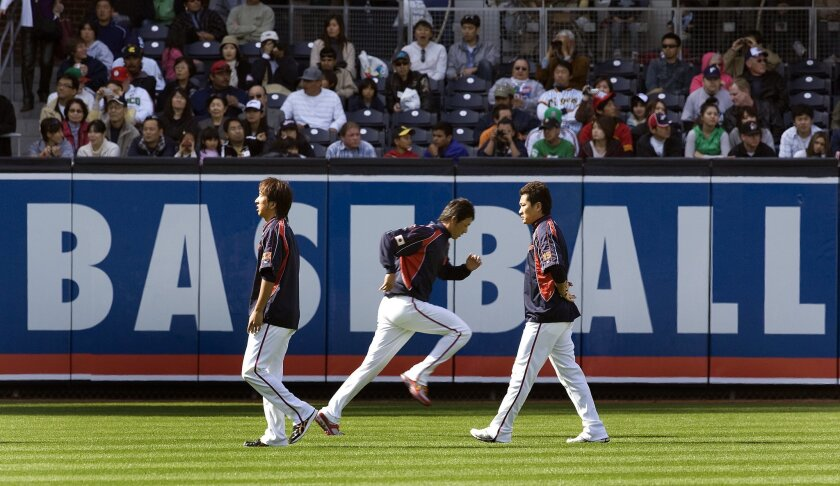 Members of Team Japan warmed up in the outfield at Petco Park yesterday in preparation for today's second-round game against Cuba in the World Baseball Classic. The two countries have established themselves as powerhouses in the sport.
