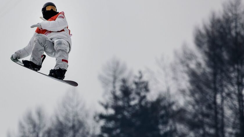 Snowboarder Shaun White practices on the halfpipe at Phoenix Snow Park.