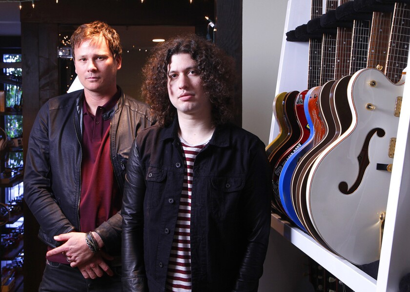 Tom DeLonge (left) and Ilan Rubin of Angels & Airwaves at the band's recording headquarters in North County in late 2014. (John Gastaldo / Union-Tribune)