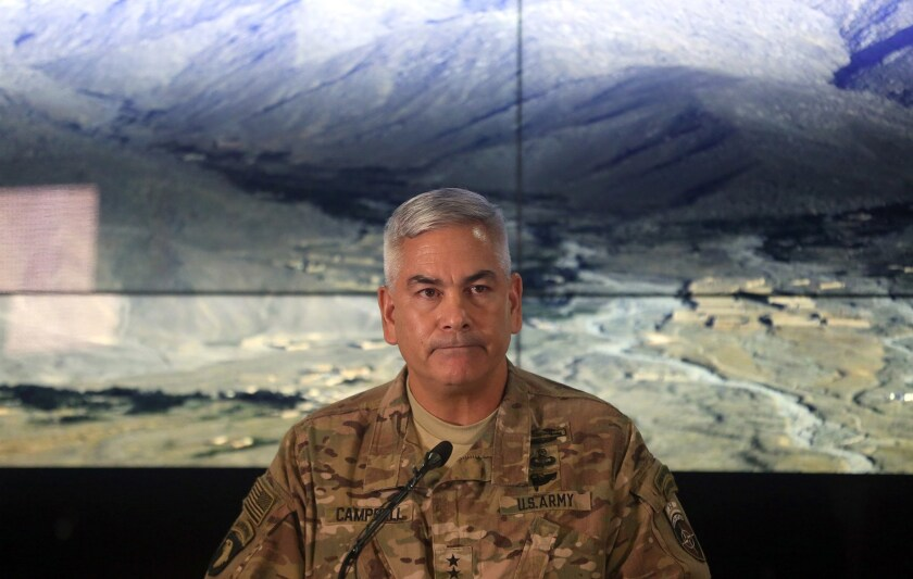 Gen. John F. Campbell, commander of U.S. and NATO forces in Afghanistan, speaks during a news conference in Kabul at which he released details of a military investigation into the deadly airstrike on a Doctors Without Borders hospital in October.