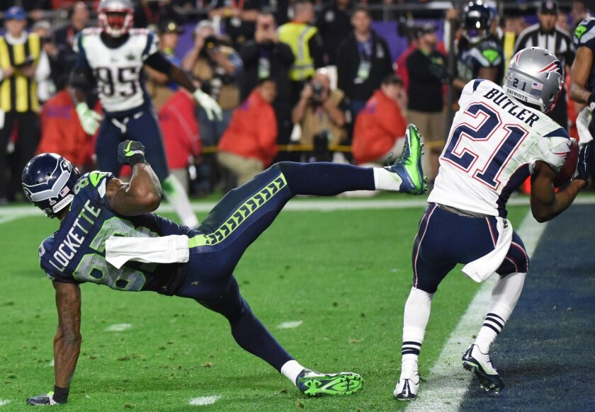 Malcolm Butler of the New England Patriots, right, intercepts a pass intended for Ricardo Lockette of the Seattle Seahawks late in the fourth quarter of Super Bowl XLIX.