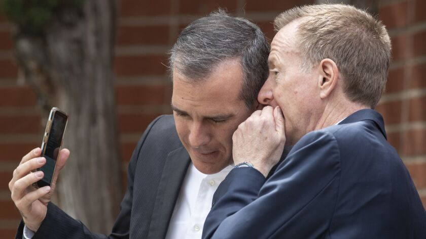 L.A. Mayor Eric Garcetti, left, confers with schools Supt. Austin Beutner during a recent event in Reseda. Their alliance behind Measure EE was not enough to win passage of the tax measure.