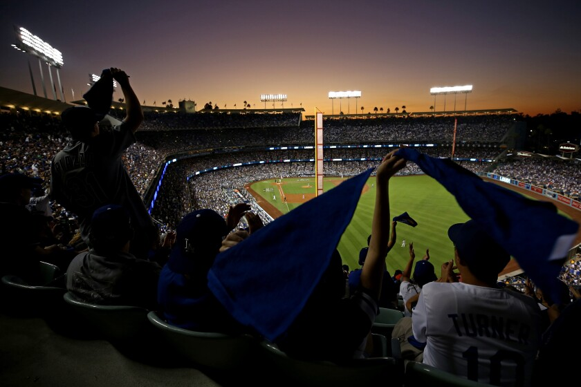Fans wave towels during Game 2 of the 2017 World Series between the Dodgers and Houston Astros at Dodger Stadium.