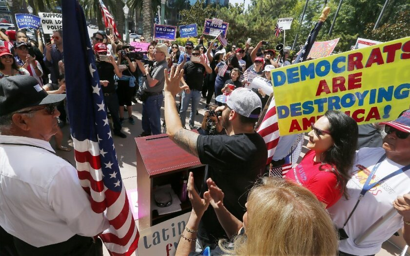 Jorge Herrera, a Los Angeles resident and a member of the political group Latinos for Trump, speaks to supporters of GOP presidential candidate Donald Trump outside Anaheim City Hall on Sunday.