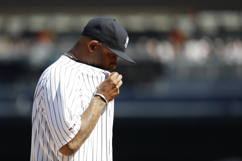 New York Yankees' CC Sabathia reacts after watching a video on the stadium scoreboard before a baseball game Toronto Blue Jays Sunday, Sept. 22, 2019, in New York. (AP Photo/Michael Owens)