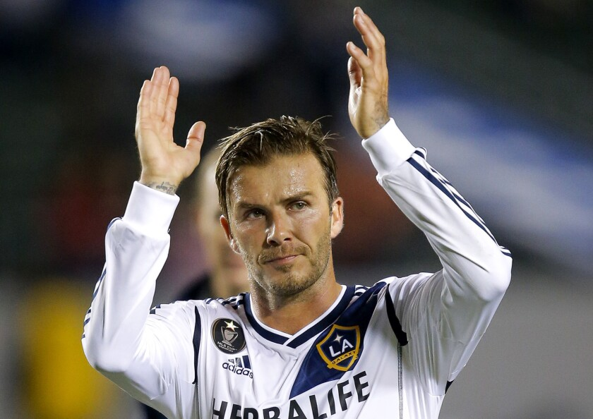 Los Angeles Galaxy's David Beckham acknowledges the fans after a game against the Vancouver Whitecaps last season.
