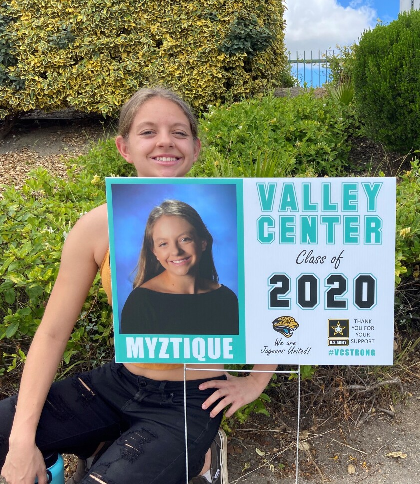 Senior Myztique Avila-Deuel poses with her personalized photo sign, posted at Valley Center High School.