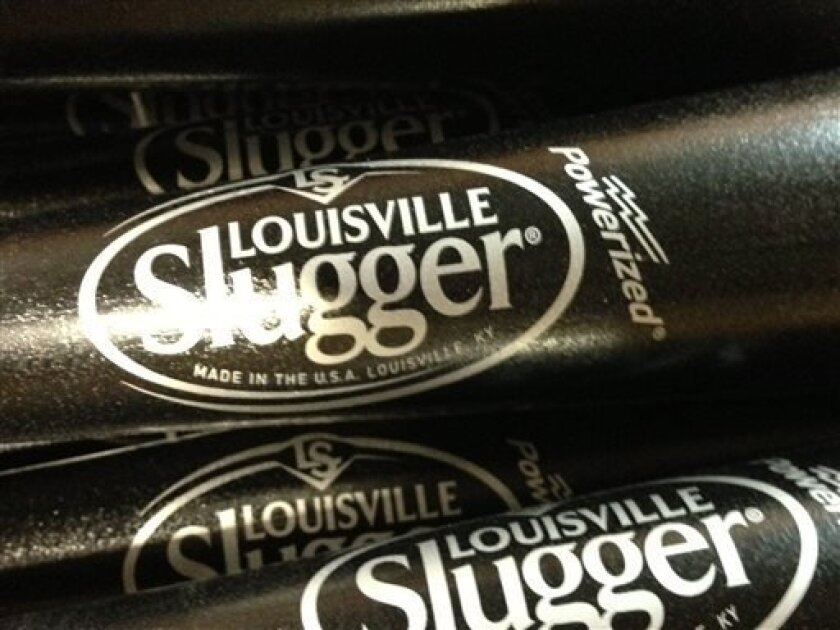 In this Thursday, March 28, 2013 photo, Louisville Slugger baseball bats are shown, in Louisville, Ky. Louisville Slugger is rolling out a new logo for the first time in 33 years on a new bat that company officials say is designed to be the hardest wooden bat ever produced at the Louisville, Ky., f