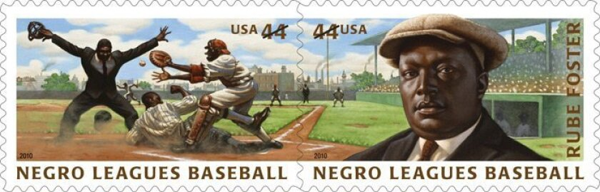 Rube Foster (right), the founder of the Negro National League, is depicted on a stamp created by Nelson. A second stamp depicts an action scene in the league.