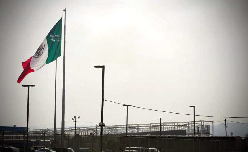 The Mexican flag flying over Tijuana, as seen from the San Ysidro border crossing into Mexico.