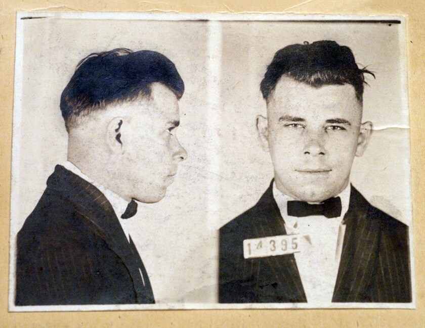 FILE - This undated file photo shows Indiana Reformatory booking shots of John Dillinger, stored in the state archives. A judge will hear an Indianapolis cemetery's bid Wednesday, Nov. 4, 2019, to dismiss a lawsuit filed by a relative of the 1930s gangster who wants to exhume Dillinger's gravesite to determine if the notorious criminal is actually buried there. (Indiana State Archives/The Indianapolis Star via AP, File)
