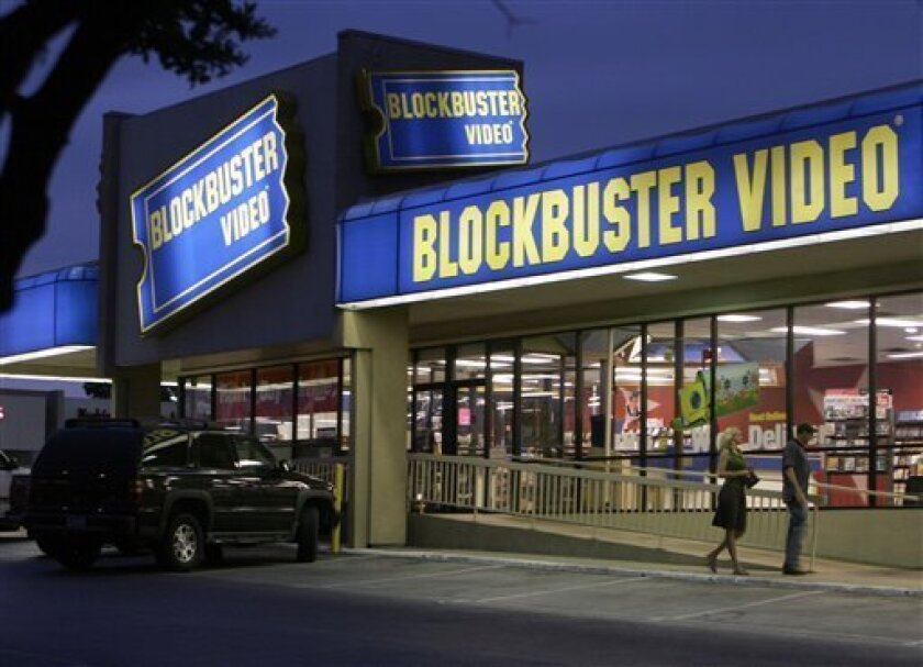 This July 23, 2006 file photo shows customers enter a Blockbuster video store in Dallas. Blockbuster Inc. will begin selling concert tickets at about 500 of its video rental stores, bolstering its effort to create a one-stop shop for entertainment. (AP Photo/Ron Heflin, File)