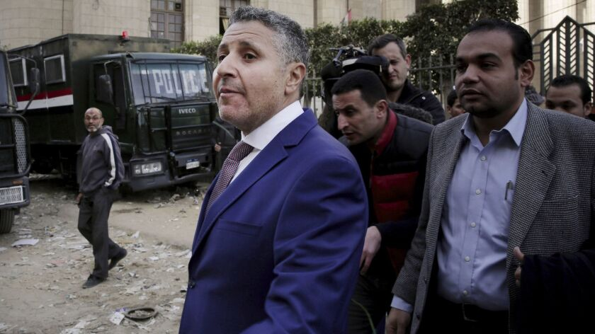 Egyptian lawyer Negad Borai, left, shown leaving court in Cairo in 2015, says at least six activists have been detained in the last couple of days in a wave of arrests coinciding with the anniversary of the 2011 Arab Spring uprising