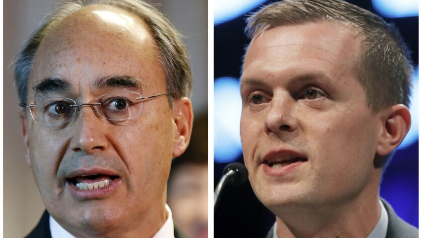 U.S. Rep. Bruce Poliquin, left, and state Rep. Jared Golden battle in Maine's 2nd Congressional District. The race will come down to an instant runoff.