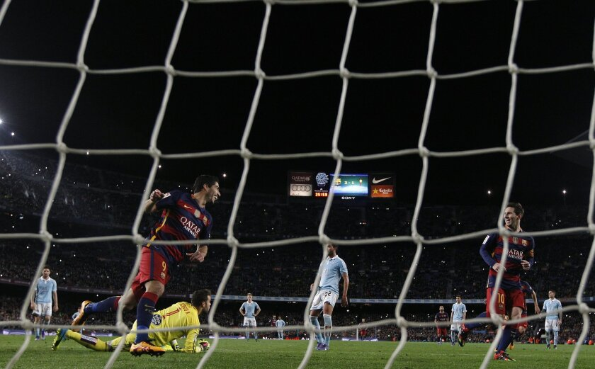 FC Barcelona's Luis Suarez, center left, celebrates after scoring a goal with his teammate Lionel Messi, second right, against Celta Vigo during a Spanish La Liga soccer match at the Camp Nou stadium in Barcelona, Spain, Sunday, Feb. 14, 2016. (AP Photo/Manu Fernandez)