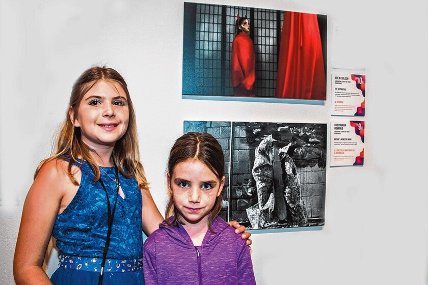 Roen Carlson, 10, also from Generations, poses with her sister, Reese, who was her model in 'The Apprentice' at Museum of Photographic Arts in Balboa Park, San Diego.