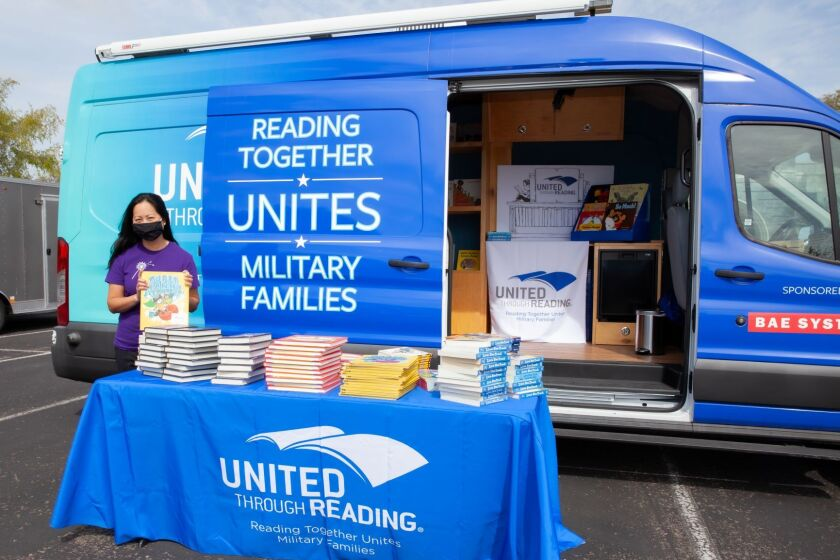 Macy's has partnered with United Through Reading to give more than 800 children's books to San Diego military families.