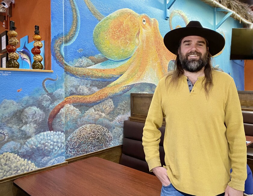 Ocean Beach resident Simon Melnyk has painted murals, including this one at Mariscos Mar de Cortez restaurant in Ramona.