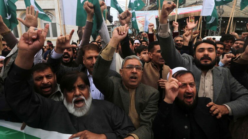 Pakistanis shout anti-India slogans as they protest in Peshawar on March 1.