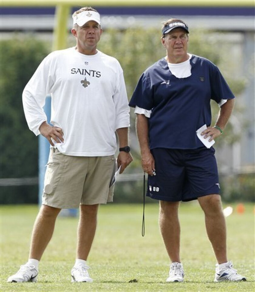New England Patriots head coach Bill Belichick, right,  and New Orleans Saints head coach Sean Payton look on during a joint football practice in Foxborough, Mass.,  Tuesday, Aug. 10, 2010. (AP Photo/Winslow Townson)