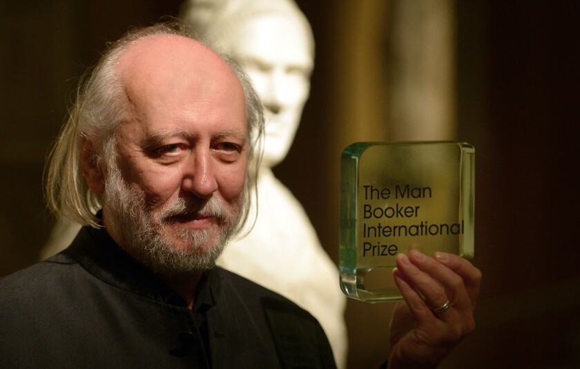 Hungarian author László Krasznahorkai displays his Man Booker International Prize in London on May 19.