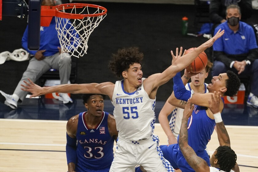 Kansas' Jalen Wilson (10) shoots as Kentucky's Lance Ware (55) defends during the first half of an NCAA college basketball game Tuesday, Dec. 1, 2020, in Indianapolis. (AP Photo/Darron Cummings)