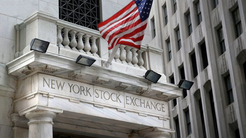 FILE - This Monday, Aug. 24, 2015, file photo shows the New York Stock Exchange. Stocks are edging h