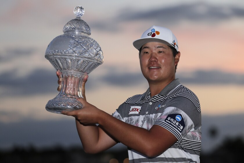 Sungjae Im of South Korea holds the trophy after winning the Honda Classic golf tournament, Sunday, March 1, 2020, in Palm Beach Gardens, Fla. (AP Photo/Lynne Sladky)