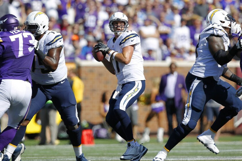 Chargers Philip Rivers throws a touchdown pass to Keenan Allen in the 2nd quarter against the Vikings.