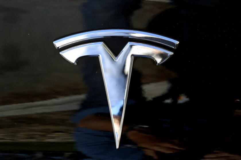 The Tesla logo seen on a car.