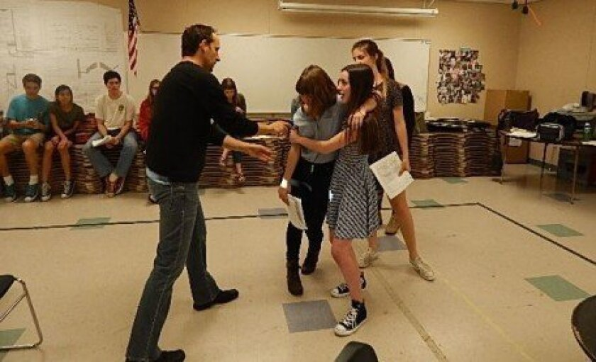 """Canyon Crest Academy students rehearse guest director Jason Maddy's adaptation of Shakespeare's """"Twelfth Night."""" Photo/Susan Farese"""