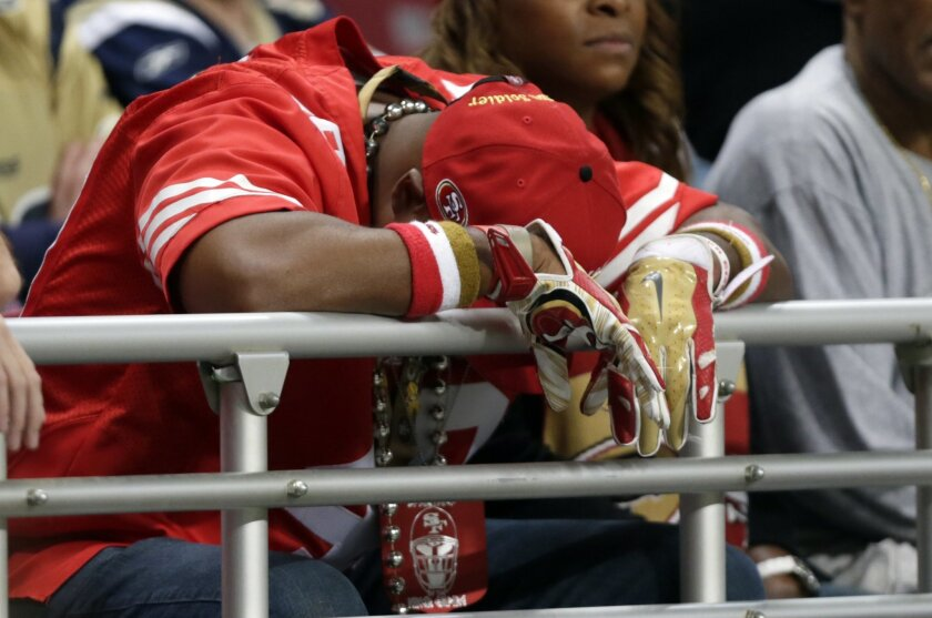 A San Francisco 49ers hangs his head in the stands during the second quarter of an NFL football game between the St. Louis Rams and the San Francisco 49ers Sunday, Nov. 1, 2015, in St. Louis. (AP Photo/Tom Gannam)