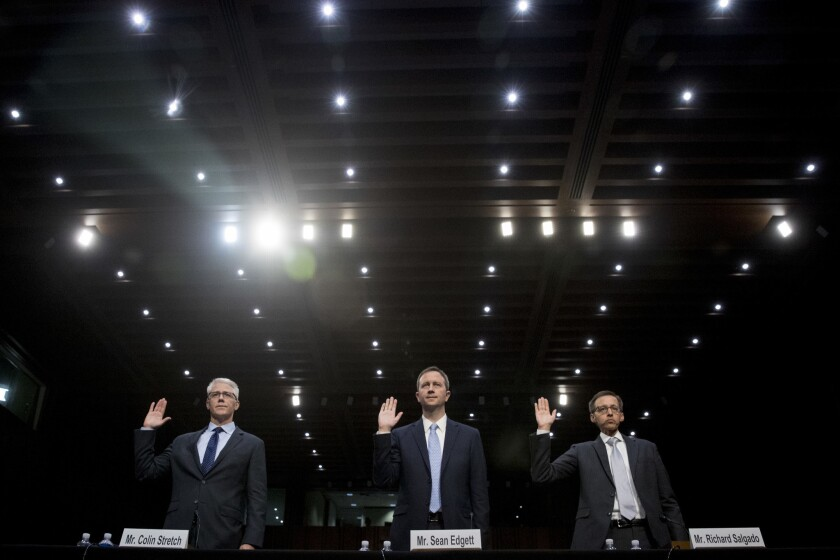 From left, Facebook's General Counsel Colin Stretch, Twitter's Acting General Counsel Sean Edgett, and Google's Law Enforcement and Information Security Director Richard Salgado, are sworn in for a Senate Committee on the Judiciary, Subcommittee on Crime and Terrorism hearing on Capitol Hill in Washington on Oct. 31, 2017, on more signs from tech companies of Russian election activity.