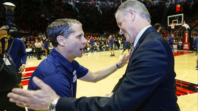 Nevada head coach Eric Musselman and SDSU head coach Brian Dutcher greet each other before the start of the game.