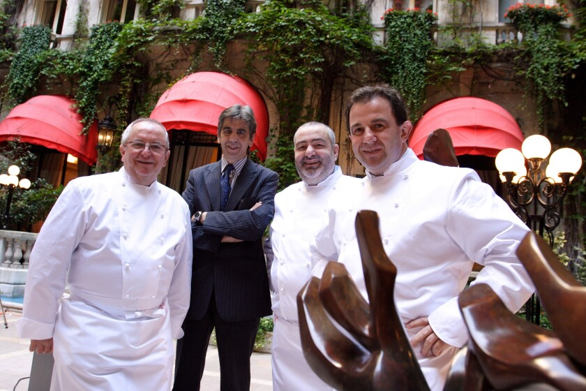 Juli Soler, second from left, with notable European chefs Juan Maria Arzak, left, Santi Santamaria and Martin Berasategui, at the Plaza Athenee in Paris in 2004.