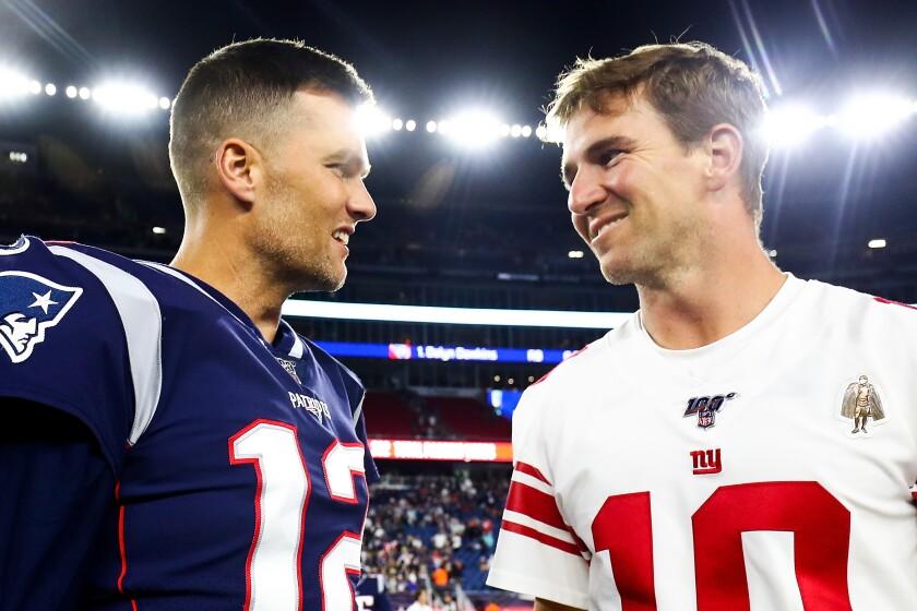 New England Patriots quarterback Tom Brady greets New York Giants QB Eli Manning after a preseason game Aug. 29, 2019