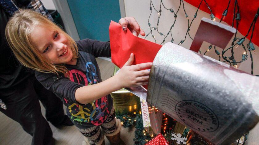 ESCONDIDO, December 5, 2017   Cierra Wright, 7, places her letter to Santa into a Santa special del