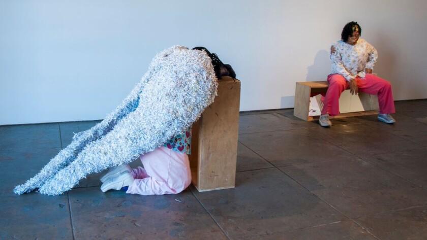 "Karon Davis' nurse sculptures: ""Morphine,"" left,  and ""Nicotine."""