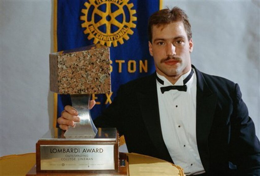 FILE - This is a Dec. 4, 1986, file photo showing Chris Spielman, senior lineman for Ohio State University, at ceremonies where he was presented with the Lombardi award, in Houston. Chris Spielman's wife was never impressed by the honors her husband received as a star linebacker at Ohio State and in the NFL. The College Football Hall of Fame was another matter. (AP Photo/Rick McFarland, File)