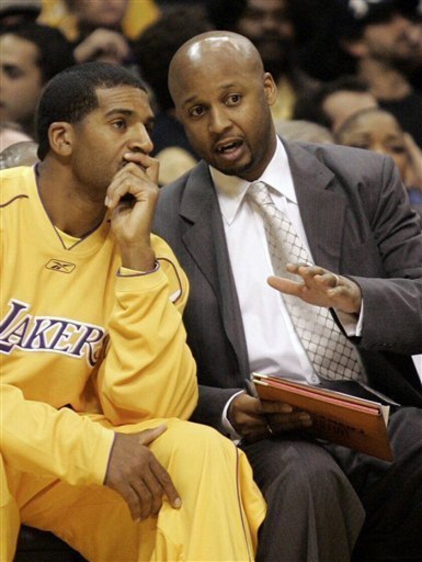 FILE - In this March 6, 2006, file photo, Los Angeles Lakers' Jim Jackson, left, discusses plays with assistant coach Brian Shaw during a NBA basketball game against the San Antonio Spurs in Los Angeles. Shaw has been given permission to interview with the Cleveland Cavaliers about their coaching vacancy. (AP Photo/ Francis Specker, File)