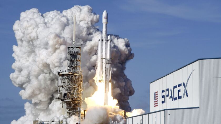 A SpaceX Falcon Heavy rocket lifts off from Kennedy Space Center in Cape Canaveral, Fla., in February.
