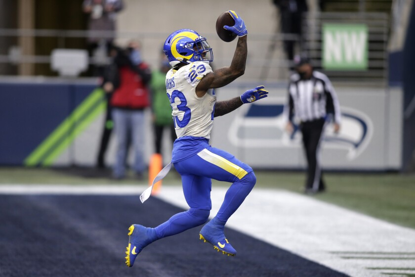 Cam Akers covers lot of ground in Rams' playoff victory - Los Angeles Times