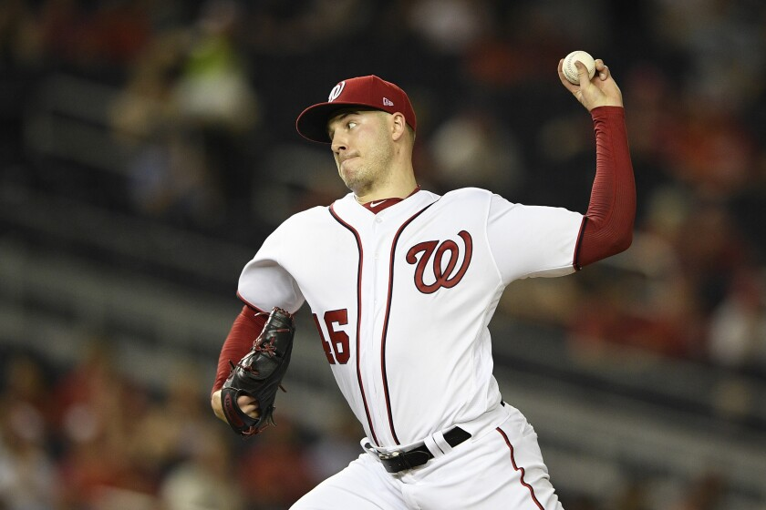 Washington Nationals starting pitcher Patrick Corbin delivers a pitch during the third inning of a baseball game against the Philadelphia Phillies, Monday, Sept. 23, 2019, in Washington. (AP Photo/Nick Wass)