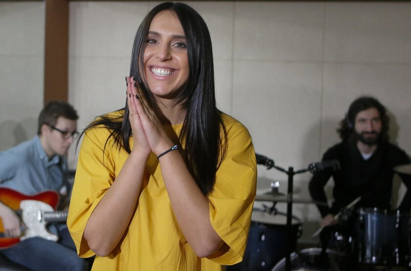 In this photo taken Thursday, Feb. 18, 2016, Ukrainian singer Susana Jamaladinova, known as Jamala, smiles at a rehearsal for the final of Ukraine's national selection for the Eurovision song contest, in Kiev, Ukraine. Ukrainians chose on Sunday night Feb. 21, 2016, Crimean Tatar singer Susana Jamaladinova, who performs under the stage name Jamala, and her song about the mass deportation of Tatars under Josef Stalin as the country's entry for this year's Eurovision song contest. (AP Photo/Sergei Chuzavkov)
