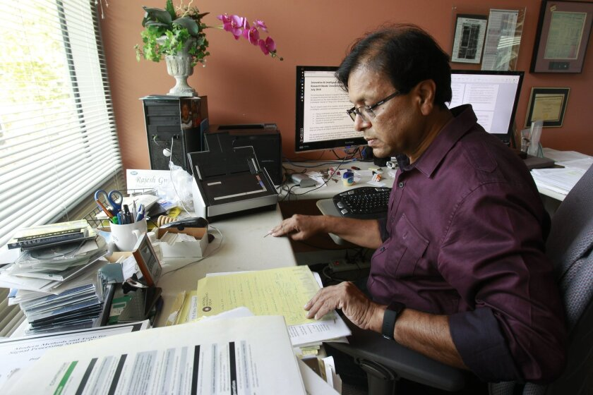 Professor of Computer Science and Engineering Dr. Rajesh Gupta in his office at the Computer Science and Engineering building at UCSD in La Jolla on Thursday.