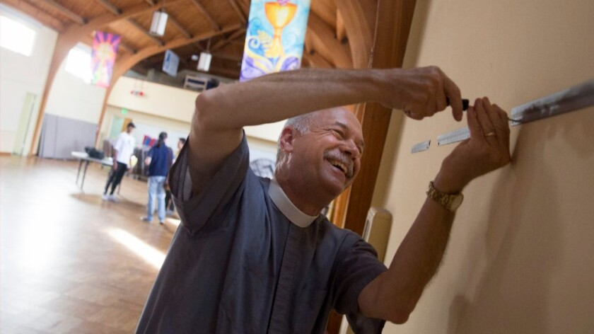 The Rev. Eric Shafer, pastor of Mt. Olive Lutheran Church in Santa Monica, puts the finishing touches on Bruin Shelter, the first homeless shelter for college students run by college students.