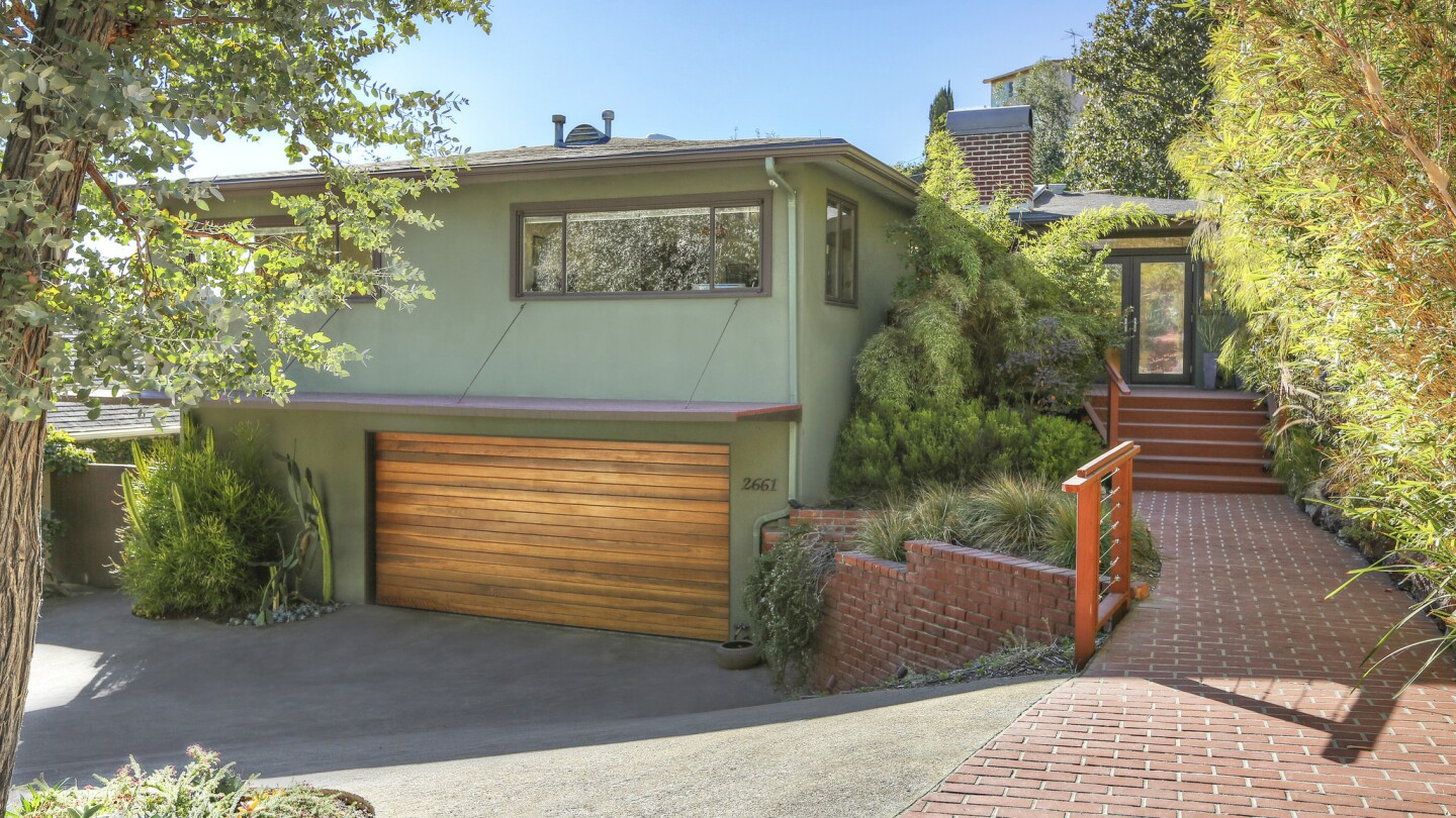 Home of the Day: A Midcentury compound with a pond in Los Feliz