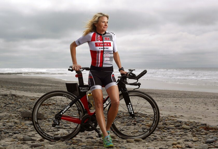 Susanne Davis of Carlsbad has been named an Ironman All World Athlete Champion. Pictured with her training bike on the beach in Cardiff, the 44-year-old mother of two is 5 feet, 7 inches, tall and 122 pounds of sheer muscle.